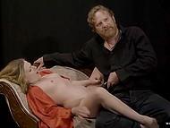 Serious guy in black clothes seduces his goddess masturbating her peach with dildo
