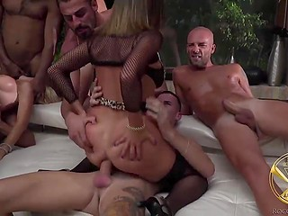 Muscular men surrounded three wonderful girlfriends and penetrated them in turn