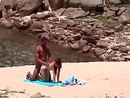 Red-haired chick bends over black guy, who massages her back and puts cock in pussy on beach 4