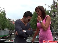 Female brings tourist in Red Lights district, where big-boobied hooker takes care of him 4
