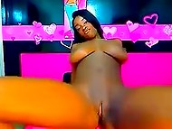 Young Ebony with giant boobs flashes her naked body on webcam and pushes dildo inside cunny 7
