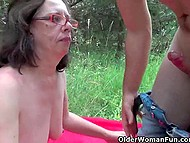 Youngster finds old brunette on the green lawn and puts small cock in her hairy anus 5