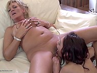 Teenage brunette together with mature female actively lick each other's vagina
