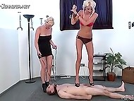 Imperious chicks in high heels mercilessly trample body and penis of helpless slave