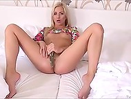 Well-groomed pussy of blonde beauty never parts with glass adult toy for too long