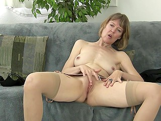 Mature woman removed her panties and spread legs to polish clitoris alone