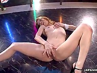 Flexible stripper from Japan burns with sexual desire every time she listens to the music