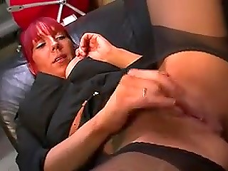 Red-haired slut from Denmark readily starts playing with dildo while interviewer is busy with recording