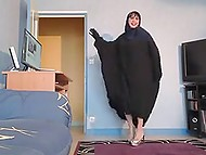 Vigorous Arab MILF dancing at hole lifting her black robe again and again to show tight panties 11