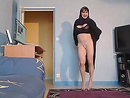 Vigorous Arab MILF dancing at hole lifting her black robe again and again to show tight panties