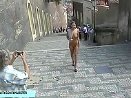 Naked brunette girl walks through small Italian streets attracting many tourists' attention 3