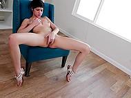 Short-haired brunette with attractive body energetically fingers trimmed vagina alone 11