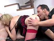 Lecherous woman in red stocking and high leather boots hooks up with two guys like crazy