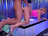 Slender blonde in high heels helps client relieve the tension, which is caused with her dancing
