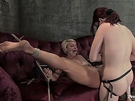 Blonde licked pierced pussy of mistress who treated her with flogger and strapon
