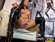 Dark-haired honey in beautiful boots exposes trimmed vagina begin watched by excited visitors 4