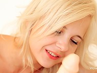Good-looking sweetie with golden hair and beautiful face greedily sucks adult toy alone 11