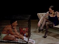 Mistress takes seat and watches dark girl sitting in cage and masturbating shaved pussy 5