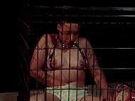 Mistress takes seat and watches dark girl sitting in cage and masturbating shaved pussy 6