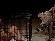 Mistress takes seat and watches dark girl sitting in cage and masturbating shaved pussy 9