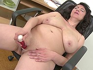 Mature secretary with big boobs stayed in office only to spend a good time with vibrator 11