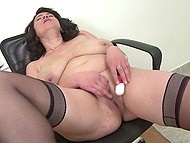 Mature secretary with big boobs stayed in office only to spend a good time with vibrator 9