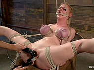 Pervert female tied up full-bosomed blonde and brought her thrill in torture room