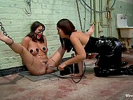 Madam in leather clothes carefully mocks poor girl to bring her peculiar pleasure
