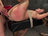 Mistress shoves dildo into asshole of tied up girl and fucks her pussy with strapon 11