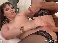 Brunette MILF Dana DeArmond gives deepthroat BJ to muscled man and he diligently fucks trimmed pussy 5