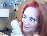 Red-haired BBW with tattooed buttocks warms up her pussy with dildo in front of webcam 10
