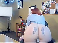 Red-haired BBW with tattooed buttocks warms up her pussy with dildo in front of webcam 4