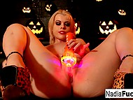 Big-tittied Nadia White with pierced nipples masturbates vagina on Halloween