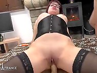 French MILF with glasses spread her buns and two guys by turns are drilling her holes