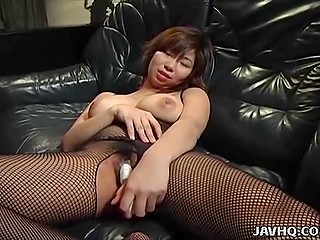 Big-breasted Japanese woman in black pantyhose gently masturbates pussy with adult toy