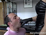 Strict mistress punishes her sex slave and forces him to suck red strapon 4
