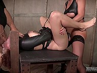 Whore is tied to BDSM table and can't move but man with MILF penetrate her holes from both sides