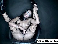 Ebony MILF Skin Diamond rubs pussy through fishnet pantyhose and plays with beads in bathtub