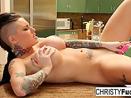 Pornstar Christy Mack with big breasts came to kitchen to knead pussy with vibrator, not cooking