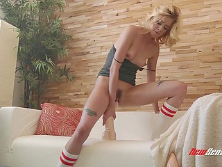 Fetching blonde has huge dildo and she tests it on trimmed pussy in solo scene