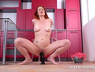 Redhead stretched pussy with gynecological mirror and pissed then stimulated it with dildo 6