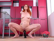 Redhead stretched pussy with gynecological mirror and pissed then stimulated it with dildo
