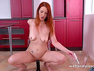 Redhead stretched pussy with gynecological mirror and pissed then stimulated it with dildo 9