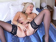 Raunchy female in black stockings gently kneads her trimmed pussy with fingers 11