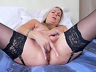 Raunchy female in black stockings gently kneads her trimmed pussy with fingers 4
