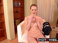 Young redhead gets a new toy for her sweet clit and immediately uses it