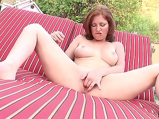 Slutty MILF removed clothes and properly kneaded trimmed vagina in backyard