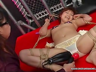 Japanese woman and her assistant touch innocent teen with various sex gadgets