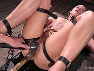 Master masturbates shaved pussy of submissive girl who is tied up and can't move
