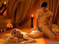 After hot bath, they move to bedroom where romantic environment immerses them in world of fantasies